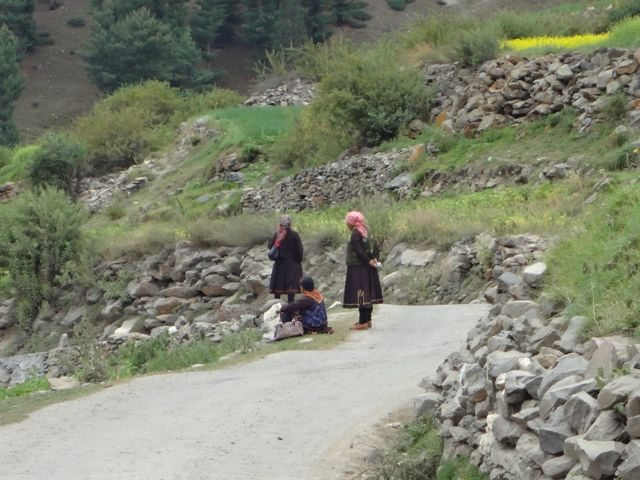 Women in the traditional attire waiting for the bus