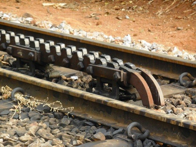 Rack rail in the middle of tracks