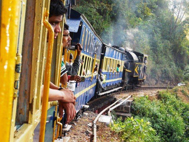People enjoying the ride and admiring beauty of Nilgiri hills