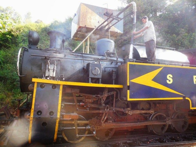 Assistant filling water in the locomotive