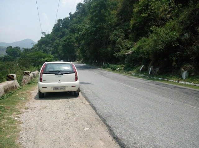 Car resting at a scenic view before Pandoh