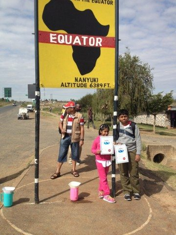 Kids with their certifcates at the Equator