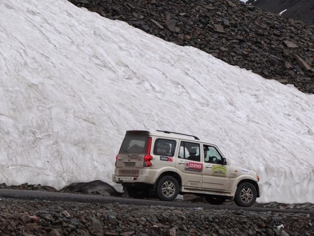 Our Scorpio against a snowy slope at Baralachla