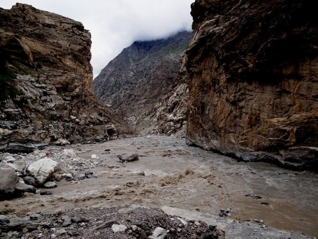 The grey waters of the Spiti mingle with the brown of the Sutlej