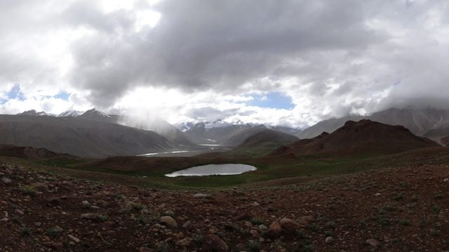 The panorama west of Chandratal complete with a small lake  and the Chandra River beyond...