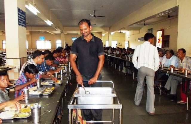 Sewadar serving food in Prasadalaya