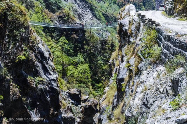 Below this hanging bridge, river Kali Gandaki is world's deepest Gorge