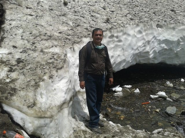 Standing in front of a glacier