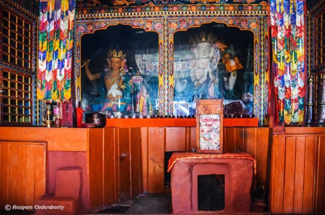 Inside the Gompa. Eternal flame can be seen inside the structure under Donation Box in the Photo
