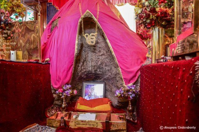 The Rock thrown by demon on Guru Nanak