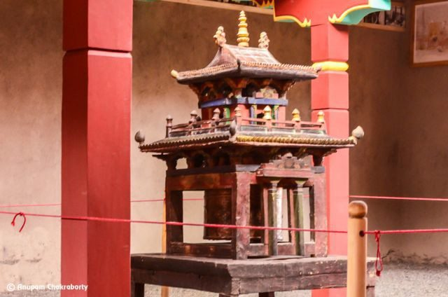 An old wooden Prayer Wheel