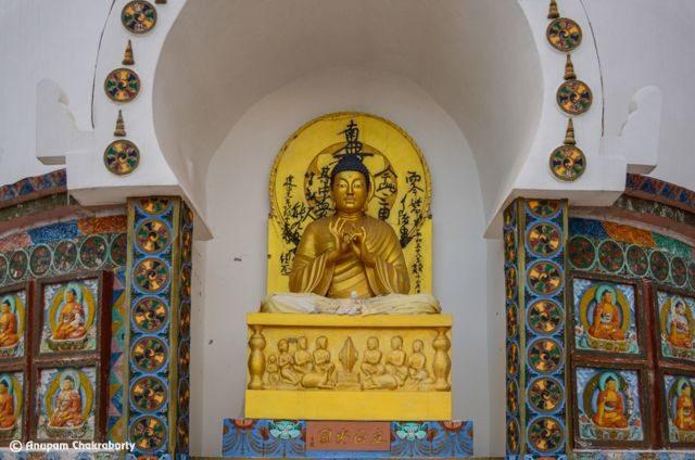 Lord Buddha sitting on the platform 'Turning Wheel of Dharma