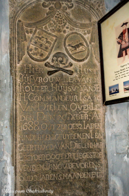 A gravestone laid on the wall of the Church