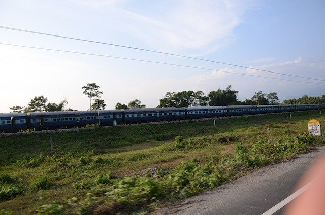 Race with the running train. National highway and railway line go side by side towards Assam.
