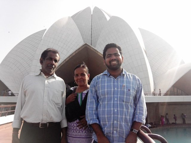 Swaraj with parents in front of Lotus temple