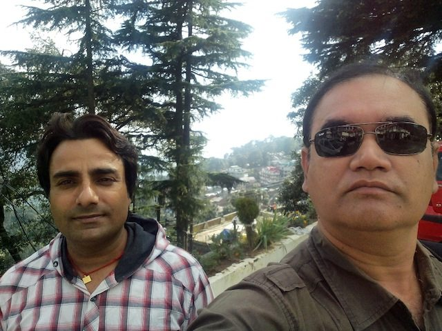 Deepak, our guide cum chauffeur with me at Dalhousie