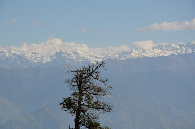 Snow-capped series of Himalayan peaks, view from Dyan Kund