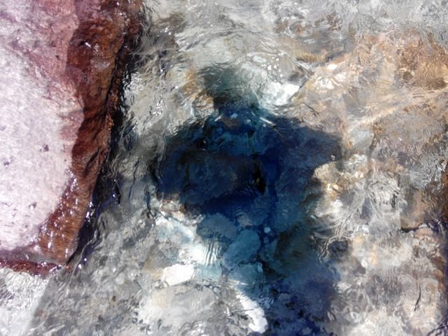 Colourful rocks, free flowing water of the fall and please don't miss my own shadow