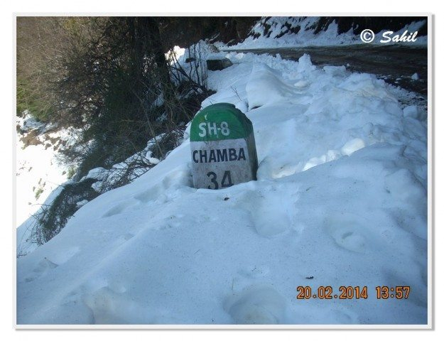 The familiar SH-8 milestone leading to Kanatal, Chamba