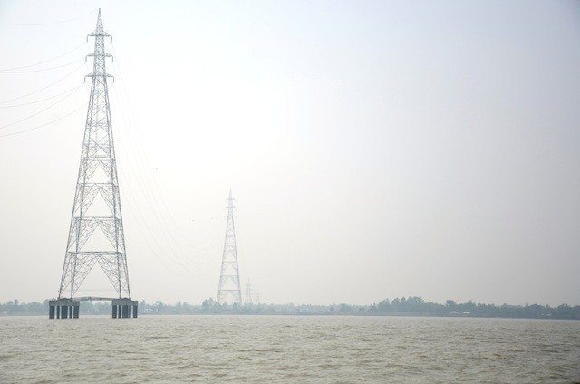 Transmission towers erected in the very deep Muriganga river. Power is transmitted to Sagar island from main land with the help of these towers