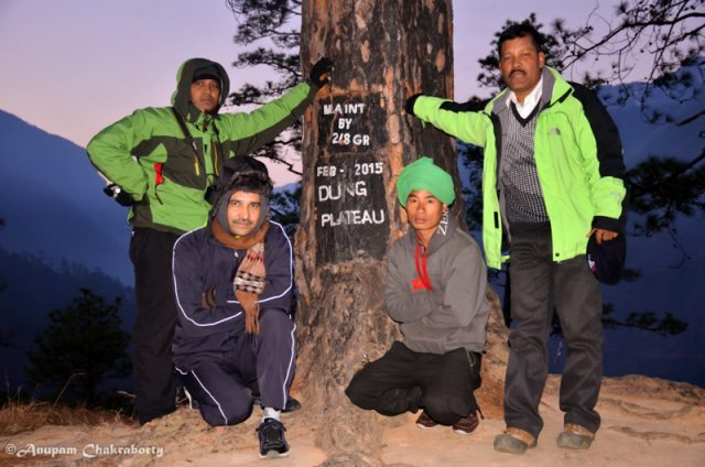 My friends on the Dong Plateau at sunrise. From Left Kamal, Chandra, guide Amit and Prakash