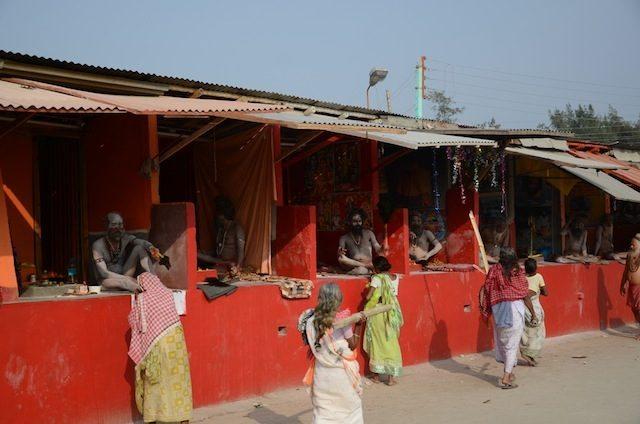 Akharas of Naga Sadhu. Ladies seeking blessing from holy men