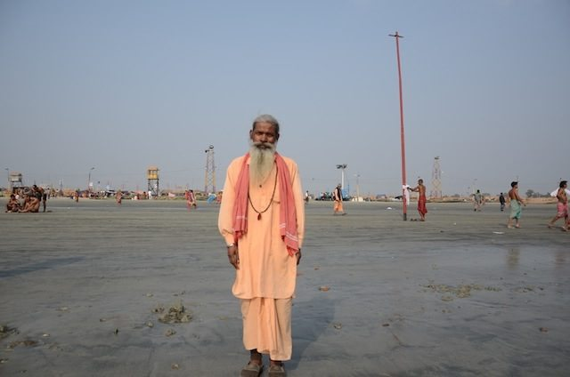 A religious man roaming alone in the beach