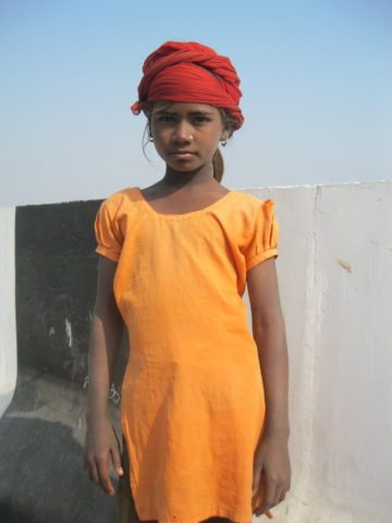 Girl on the bridge; don't miss the head-gear!